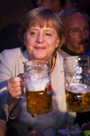 Angela Merkel joins a toast with a beer